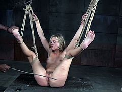 Sasha, being tied up in the position she's in, probably shouldn't irritate her executor. He shows her who's the boss, by choking her and punishing her pussy with the old favorite dildo on a stick. What she really wants, is that black dick inside her.
