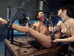 Nikki Darling is in need of some fresh feelings so, her mistress Siouxsie, will give her them. With legs wide apart, ebony babe is placed in a special bondage device, with electrical butt plug. Her pink pussy was fingered by her lesbian lover and aroused with the help of vibrator. Refined pleasure filled with electricity!