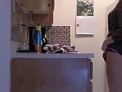 Hot stepmother Teases And Masturbates In Kitchen