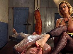 cruel mistress dominates and punishes her sex slave