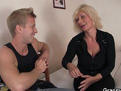 Old blonde women pleases young guy