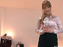 Japanese masseuse in a satin blouse jerking off a dude's dick