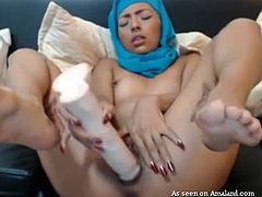 Busty tattooed girl in hijab on her head was trying to satisfy her itching pussy with a huge fake dick. That gigantic dildo became wet with the excretions, which were coming out of her pussy. She was jut trying to fulfill her own needs!