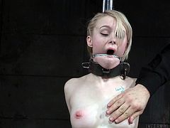Slim and fragile Anna Tyler, is subjected to humiliation by the severe executer. She harshly attached to the wooden beam, her nipples are pinched with metal clamps and her clit is stimulated with special electro device. Anna can't scream or ask for the help, because her mouth is stuffed with... Have fun and enjoy severe bdsm action!