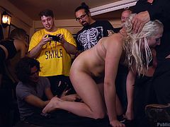 Looks like the crowd enjoys this public humiliation more, than main hero, blonde busty babe, Liz Rainbow. Watch her sucking dick and balls publicly, on knees, with wild passion. Viewers appreciate the show and constantly make hot photos. Relax and enjoy hardcore action!