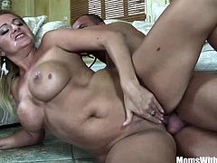 Mouth fucked big titted blonde milf Lindsay Foxx hardcore couch banging and receives a warm facial.