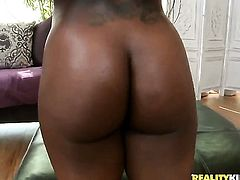 Piercings ebony bounces up and down on ram rod in interracial action