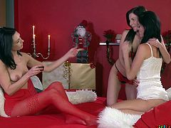 These girls know, how to spend the Christmas holidays properly. Get rid of the boredom, they decide with the help of good lesbian threesome. And it's actually the best idea, I've ever met. Sensual nipples sucking, leads to impetuous dildo fuck. And the deeper it penetrates, the better it feels. Relax and enjoy the juicy details!