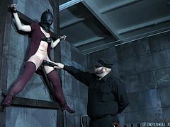 Bianca cannot see what is happening to her, but she knows, she's not on the ground. She's tied up on the wall, while her executor fucks her with a dildo on a stick and pulses her clit with a vibrator. Meanwhile, Mary Jane is tied up in the center of the room, blindfolded and gagged.