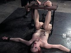 Violet Monroe was bounded in such a way, that even a single inch movement in her legs will cause enormous pain to tits. Her feet were tickled by a cruel master and he ignored all painful screams. She was horrified at first, but at the end of the session, her pussy was soaking wet.