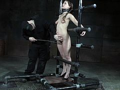 Devilynne is captured in a special device made of pipes and her body, is also tied to those pipes, while she is totally helpless. The master is playing with her pussy, stimulating it with vibrator, when she is crying with pain.