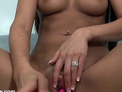 Nikki Daniels pumping a toy into her shaved pussy