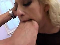 SHE IS A BLOND FOOT BITCH AND SHE LOVES IT