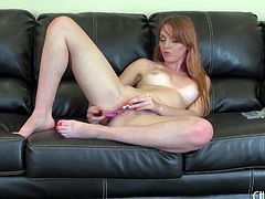 During a hot cam show this redheaded babe gets herself off