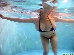 Unfaithful Japanese wife with huge breasts popping out of a tiny bikini takes a dip in a love hotel swimming pool before going skinny dipping followed by a titjob and blowjob with English subtitles
