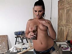 Eve Angel does her best to give herself as much pleasure as she can