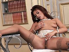 Ella Brawen with tiny tities and trimmed bush gives pleasure to herself with the help of sex toy