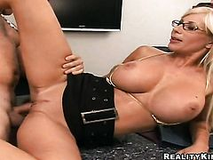 Blonde Puma Swede with huge breasts and bald pussy makes mans love wand stiff and hard