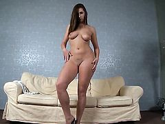 Paige Turnah with gigantic boobs and smooth twat toys her vagina