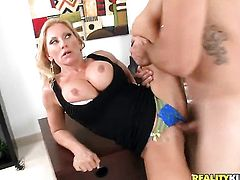 Blonde Charity Mclain with big boobs and bald twat makes man happy by sucking his meat stick