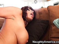 Mature Tara Holiday with massive tits and trimmed muff parts her legs to fuck herself with sex toy