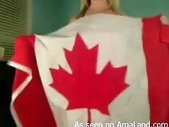 hot canadian chick strips in front of camera