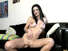 Busty tease strips and flashes her shaved cunt