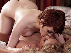 Pale redhead and her tanned friend in the 69 lesbian pussy licking