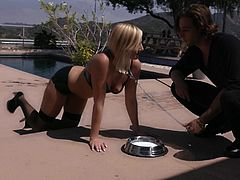Kate is led on her leash outside by the swimming area. She follows all commands and gets a drink of milk from her dish. After her walk, her master decides to give her another treat. Good girls who listen get laid!