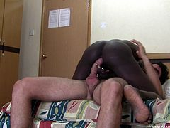 Ebony-skinned whore with small perky tits sucking a  big white cock