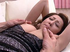 Yumi was lying on bed, when her step-son tried to seduce her. He kissed her and moved hands on chest. He slipped her top down and big boobs were hanging out. He grabbed them and sucked them hard. He pinched the nipples and started to rub her pussy slowly. She got on knees and allowed him to finger her holes from behind.