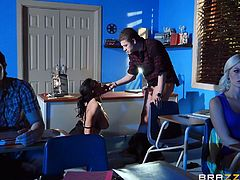 While teaching the college students about sex, ed Xander and hot teacher Romi get naughty themselves. While the film is playing, the teacher and her aide are fucking hard in the back of the classroom. She bounces up and down on his cock, on top of the desk.