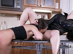 Dark beauty in a blouse fucks a lesbian on the kitchen table