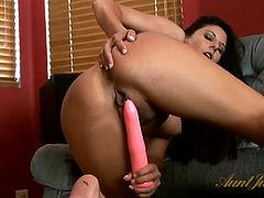 Pink dildo pushing deep into the cunt of Nikki Daniels