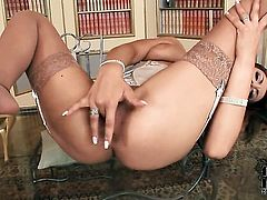 Ella Brawen with small tities and bald snatch has fire in her eyes as she dildo fucks her muff