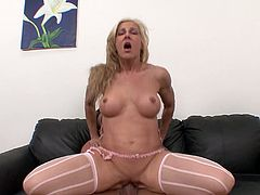 Fitness milf and a muscular man fuck with wild energy