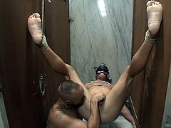 Scott Riley was tied-up and suspended in air. These two dominant masters occasionally pleased him by offering blowjob and fingering his butt hole, but most of the time, they tortured him, by slapping his big white dick and tickling feet. They finally allowed Scott to cum.