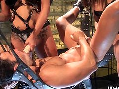 Gwen and her friend decide to turn the tables on this guy and dominate him instead. They get the strap on out and put it on, fucking him in the ass. The ladies take turns, and they also jerk him off some, to make up for it.