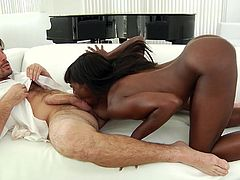 Black erotic babe sat on Manuel's face and made him eat out her pussy, and lick her ass. She stroked off his big dick. This is one hot 69 scene. She takes the big white cock deep in her cunt and loves it.