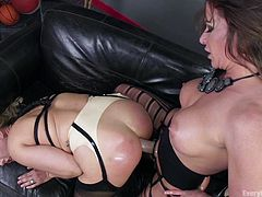 She wanted to get fucked and her lesbian friend buckled a strap-on and started banging. Their oral session was passionate and they fondled each other's boobs and fingered. Angel Allwood was fucked hard and her lesbian partner fisted asshole to its maximum.