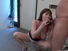 She's a real Japanese beauty with big tits who knows how to suck cock