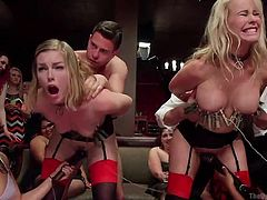 Sex slaves wearing collars and kinky stockings are being fucked in front of a large audience. Besides tits torture, these slutty bitches get aroused with kinky toys, such as vibrators, while their hands are tied with ropes. Enjoy the inciting scenes!