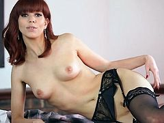Stockings and garter belt on a hot English redhead