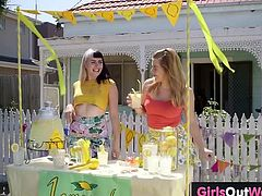 Two lesbian babes, hairy Marina and trimmed Zelder, sell fresh lemonade in front of the house before they move inside to lick each other