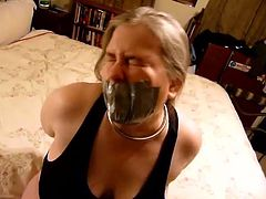 Slave girl can't get loose from duct tape gag