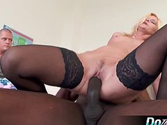 Mature blond milf enjoys a thick black cock in front of her husband and gets creampied