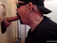 A local Baseball player, with the Durham Bulls, catches my videos and comes by for a hot blow and go. Wearing his ball cap, he arrives with a nice bulge in his tight fitting jeans. Hes got a steel cock ring on to make his dick fatter and sack engorged with a thick load of juice for his willing gloryhole cock sucker. Watch as he unloads his creamy wad on my face and mouth.