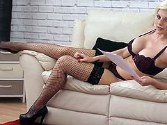 Stunning blonde reads a dirty story in lingerie