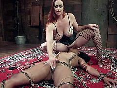 Today, Bella Rossi has something special on menu, pretty ebony babe Cali Confidential. First she stimulated her clit with vibrator, while Cali was hanging in the middle of the room, tied with ropes. Then she attached clothespins on the sex slave's belly and sat on her face with her already wet pussy...