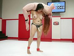 Izamar Gutierrez tasted victory in the naked wrestling match and she decided to celebrate her victory, by fucking Bella Rossi. With all her strength, Izamar started giving hard strokes, by putting strapon and Bella had great fun in the post-match session.